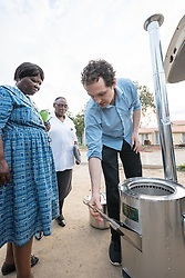 """2 March 2017, Morija, Maseru district, Lesotho: Adam Creighton, development director of InStove donates a 20-litre stove autoclave system to Scott Hospital clinical manager Ella Ramatla. The stove is to be used at the Materiel Health Centre in the district of Mafeteng, Lesotho, at a satellite learning centre run by Scott Hospital. The stove autoclave system can be used either to sterilize medical equipment, including waste, or as a cookstove. It runs on small amounts of renewable biomass. The rationale is that small pieces of biomass can be used as fuel more sustainably than when stoves require large-piece firewood. Scott Hospital is run by the Lesotho Evangelical Church in Southern Africa and is a founding member of the Christian Health Association of Lesotho. It is located in the village of Morija, and operates and supervises clinics in the Maseru District of Lesotho. Scott started out as a dispensary in 1864, and today offers comprehensive healthcare Mondays-Fridays, as well as pharmaceutical services around the clock. Lesotho suffers from high numbers in Tuberculosis in disesase and mortality, and so the hospital screens all patients for TB. The hospital observes among many patients what they describe as """"low health-seeking behaviour"""", services are increasing and demand rising, but space and human resources are a challenge, as is funding. I key concern is one of infrastructure, where the original design of the hospital matches poorly with current needs, as departments and buildings are scattered, posing a challenge for security. Another challenge is to adapt donation structures, so as to be able to receive payments electronically. The hospital has one ambulance, which they describe as not enough, but what they have. Another challenge is that lack of funds affects maintenance of buildings and infrastructure, as the immediate care of patients take priority. PLEASE NOTE: This photo is not to be used in social media."""