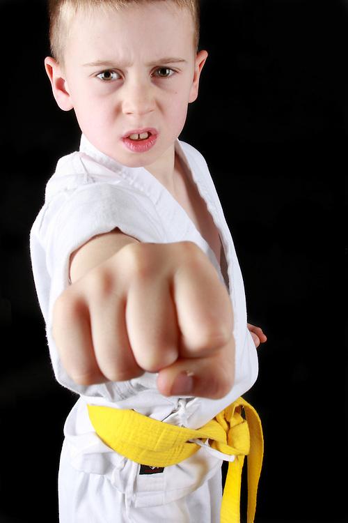 Yellow belt. Young boy practising karate.