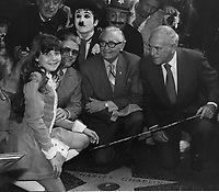 1972 Charles Chaplin's granddaughter, Susan Maree Chaplin, kneels during Charlie Chaplin's Walk of Fame ceremony