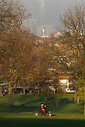 Young couple in quiet moment while sitting in Brockwell Park, Herne Hill, South London.