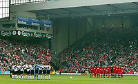 Liverpool and Fulham's players and fans stand to observe a moments slience in memory of the 96 victims of the Hillsborough disaster 14 years ago on April 15th before the Premiership match at Anfield, Liverpool, Saturday, April 12th, 2003.<br /> <br /> <br /> Pic by David Rawcliffe/Digitalsport