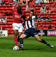 Photo: Dave Linney.<br />Walsall v West Bromwich Albion. Pre Season friendly. 15/07/2006.Walsall's Tony Bedeau(L) rides the challenge from West Brom's  Darren Carter