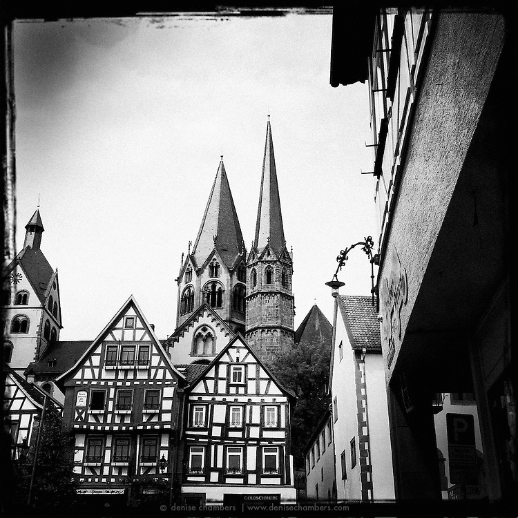 The steeples of the Church of St. Mary rise above the half timber houses as seen from the Untermarkt in Gelnhausen, Germany.