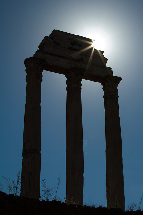 """Rome forum columns backlit by the sun.<br /> <br /> Available sizes:<br /> 12"""" x 18"""" print <br /> 12"""" x 18"""" gallery wrap<br /> See Pricing page for more information."""