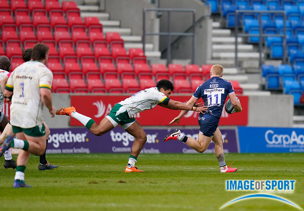 Sale Sharks wing Aaron Reed breaks away from London Irish Wing Ben Loader during a Gallagher Premiership Round 14 Rugby Union match, Sunday, Mar 21, 2021, in Eccles, United Kingdom. (Steve Flynn/Image of Sport)