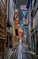 Narrow Passage After the Rain in the Bryggen Section of Bergen, Norway. Semester at Sea, Summer 2014 Semester Voyage. Composite of 3 images taken with a Leica X2 camera (ISO 100, 24 mm, f/3.5). Raw images processed with HDR Efex Pro, Capture One Pro, and Photoshop CC.