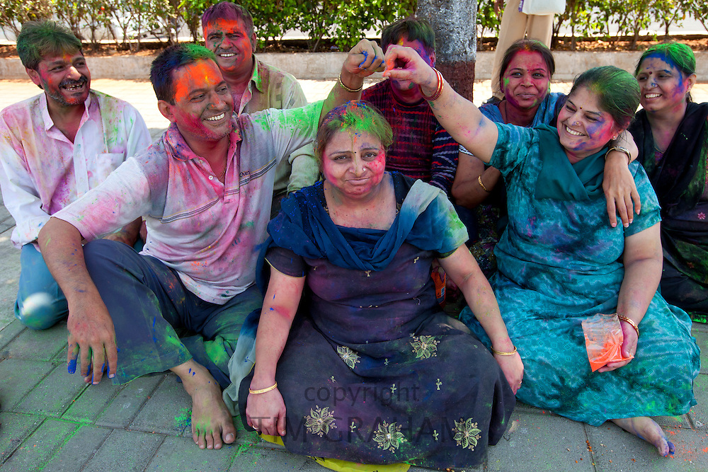 Indian people mark Hindu Holi festival of colours with powder paints in Marine Drive, Mumbai, India
