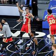 ORLANDO, FL - MARCH 03: Trae Young #11 of the Atlanta Hawks celebrates with John Collins #20 of the Atlanta Hawks after a come from behind victory over the Orlando Magic during the second half at Amway Center on March 3, 2021 in Orlando, Florida. NOTE TO USER: User expressly acknowledges and agrees that, by downloading and or using this photograph, User is consenting to the terms and conditions of the Getty Images License Agreement. (Photo by Alex Menendez/Getty Images)*** Local Caption *** Trae Young; John Collins