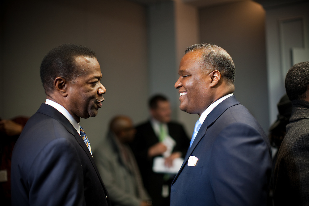 UPPER MARLBORO, MD - DECEMBER 6: Prince George's County Executive-Elect Rushern Baker III talks to former Prince George's County Executive Jack Johnson before the inauguration ceremony at Prince George's County Administration Building on his inauguration day on December 6, 2010 in Upper Marlboro, Maryland. (Photo by Michael Starghill, Jr.)