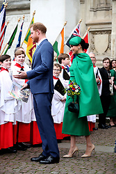 The Duke and Duchess of Sussex speak to choristers as they leave Westminster Abbey, London, following the Commonwealth Service on Commonwealth Day.