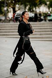 Street style, Caroline Hu arriving at Ludovic de Saint Sernin Spring Summer 2022 show, held at Institut du Monde Arabe, Paris, France, on Ocotber 3rd, 2021. Photo by Marie-Paola Bertrand-Hillion/ABACAPRESS.COM