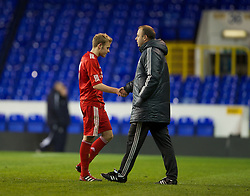 LONDON, ENGLAND - Wednesday, February 1, 2012: Liverpool's Ryan McLaughlin is consoled by reserve team head coach Rodolfo Borrell after losing 1-0 to Tottenham Hotspur during the NextGen Series Quarter-Final match at White Hart Lane. (Pic by David Rawcliffe/Propaganda)