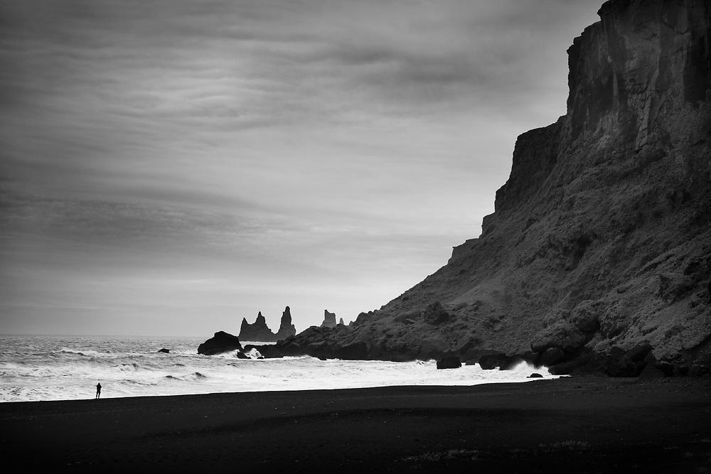Reynisdrangar, basalt sea stacks, from Reynisfjara black sand beach, Cape Dyrholaey near Vik, Iceland.