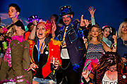 Glastonbury Festival 2014.<br /> 4am drug fueled dancers in the hub of Shangri La<br /> Shangri-La is the after-hours epicentre of Glastonbury Festival, a largely indescribable, ephemeral and interactive world that really comes to life after dark.<br /> Unique among festivals, Shangri-la has a central narrative that pins it all together,  it evolves year by year (a bit like Star Wars). All contributors respond to this narrative, and add to it via their installations, venues and performances. When it all comes together on site the audience have a wholly immersive world to become lost in with a myriad of places to explore.<br /> Exploration and discovery is an important aspect of  Shangri-la. A maze of covered alleys is riddled with nano-venues, performers and installations, artworks and hidden doors.<br />  In 2014 Shangri-La explored the way we create heavens and hells for ourselves.