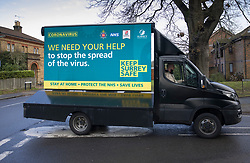 © Licensed to London News Pictures. 02/02/2021. Woking, UK. An advertising van carries a health message as Covid testing kits are distributed to residents in Goldsworth Park, Woking in Surrey, where cases of the South African variant of Covid-19 have been found. Public health England are carring out surge testing for selected parts of the Goldsworth Park, St Johns and Knaphill areas of Woking this week. Photo credit: Peter Macdiarmid/LNP