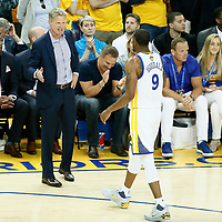 04 June 2017: Golden State Warriors head coach Steve Kerr congratulates Golden State Warriors forward Andre Iguodala (9) during the Golden State Warriors 132-113 victory over the Cleveland Cavaliers, in game 2 of the 2017 NBA Finals, at the Oracle Arena, Oakland, California, USA.