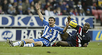 Photo: Aidan Ellis.<br /> Wigan Athletic v West Bromwich Albion. The Barclays Premiership. 15/01/2006.<br /> Wigan's Lee McCulloch appeals for a free kick after being fouled by West Brom's Darren Moore