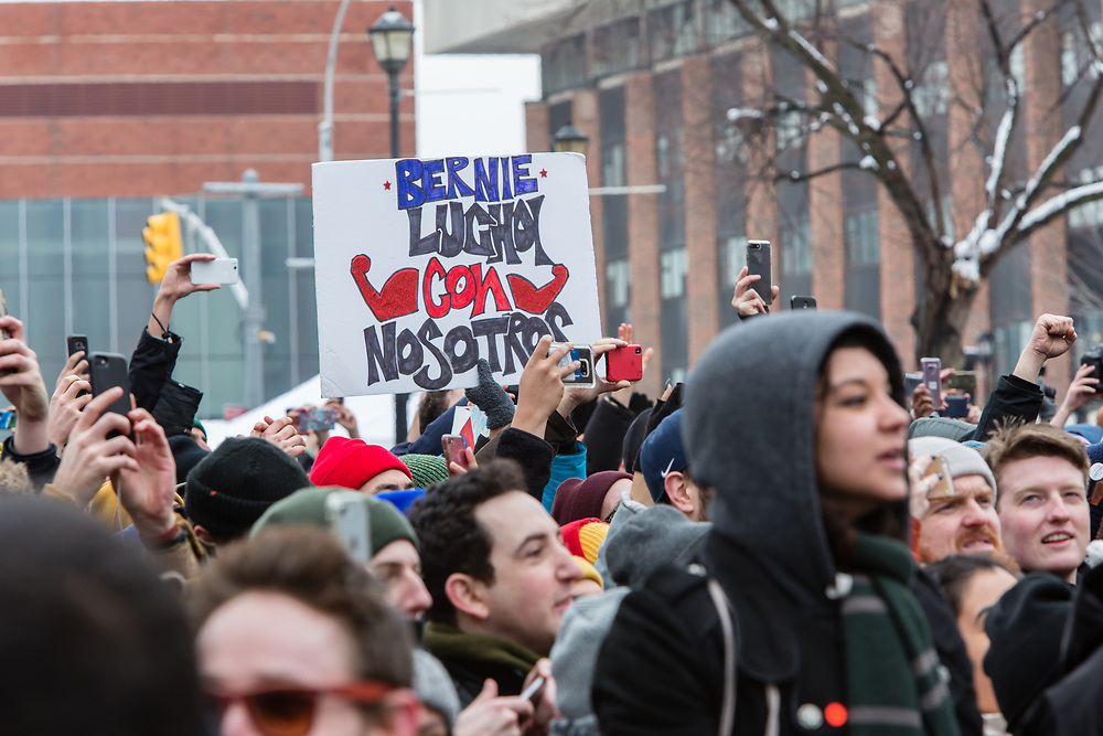 """Brooklyn, NY - 2 March 2019. A sign pm Spanish reads """"Bernie luchoi [sic.] con nosotros"""" at Bernie Sanders' first rally for the 2020 presidential primary at Brooklyn College. Rough colloquial translation, """"Bernie struggles with us."""""""
