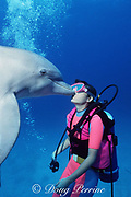 guest kisses a trained bottlenose dolphin, Tursiops truncatus, at UNEXSO's The Dolphin Experience, off Freeport, Grand Bahama Island, Bahamas ( Western Atlantic Ocean )