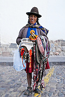 A quechua woman selling woven products in Cusco, Peru