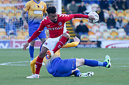 Neal Bishop of Mansfield Town (6) and Nicky Ajose of Charlton Athletic (25) battle for the ball during the The FA Cup match between Mansfield Town and Charlton Athletic at the One Call Stadium, Mansfield, England on 11 November 2018.