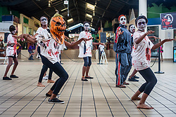 """Students from several schools warmed up the crowd with their own tribute to the """"King of Pop""""  by performing several ofhis greatest hits.  Students began practicing Monday for  this performance.  Dancers of """"Invincible"""", a Michael Jackson tribute, will perform at Reichhold Center for the Arts Saturday at 7pm.  Tutu Park Mall.  1 November 2013.  © Aisha-Zakiya Boyd"""