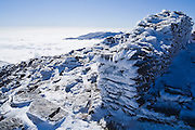 Ruins of a stone shelter covered in hoar frost on the summit of Mulhacen in Sierra Nevada National Park, Andalusia, Spain. Mulhacen is the highest mountain in continental Spain and in the Iberian Peninsula.