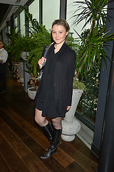 AMBER ATHERTON at the mothers2mothers World AIDS Day VIP Lunch with Next Management & THE OUTNET.COM held at Mondrian London, 19 Upper Ground, London on 1st December 2014.