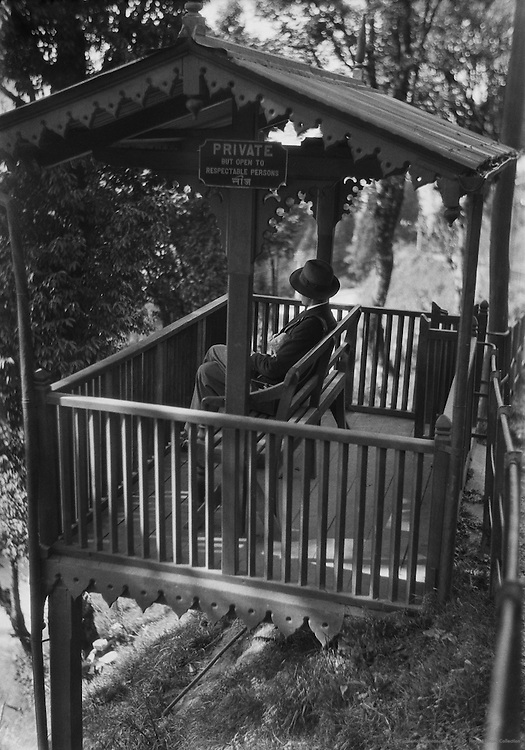 Man in Hat Sitting in a Gazebo Looking at the View, Rest House on the Way to Siliguri, India, 1929