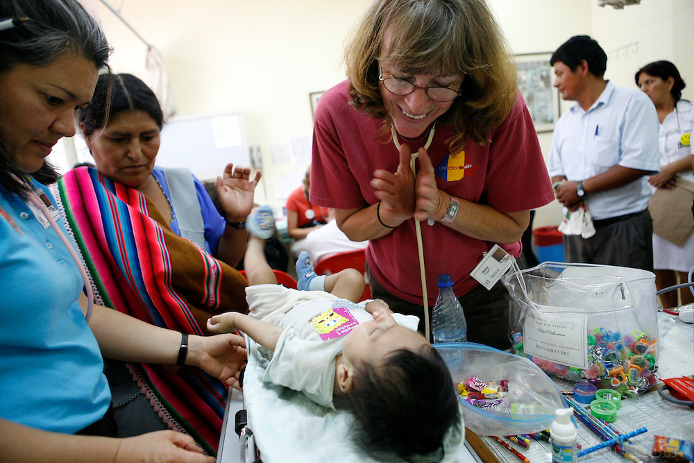 Nurses Betty Rogers, right, and Sonja Ohsiek, left, examine Luis Roberto Ticilla Cruz, 8 months old, on the first day of screening at the Hospital Japones in Santa Cruz, Bolivia on Friday, November 9, 2007, during Operation Smile's World Journey of Smiles...Photograph by Erin Lubin