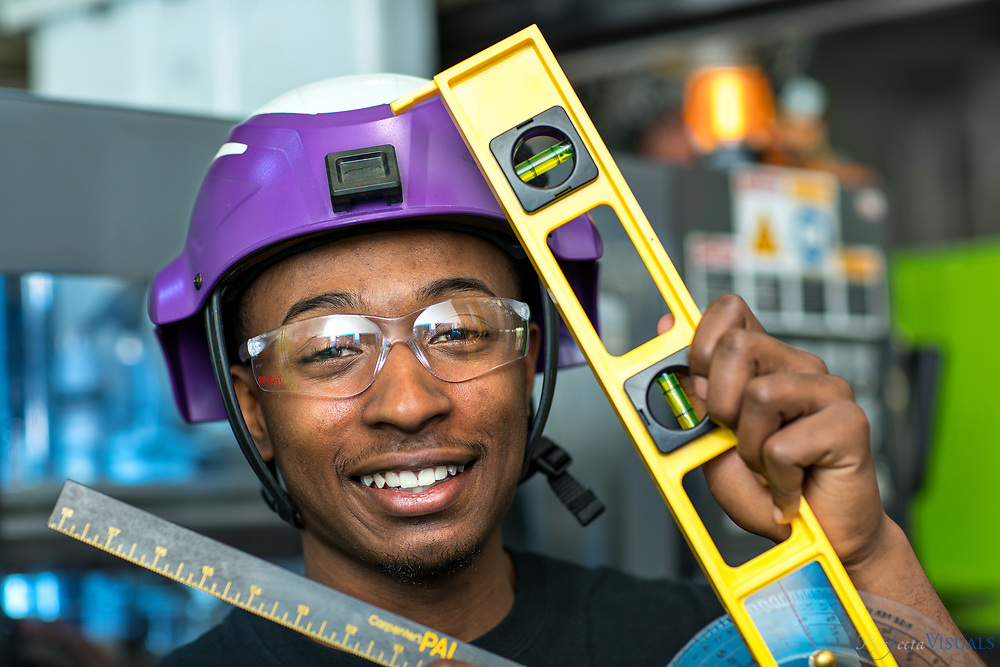 Phillip Fuller, 2017 High Point Central High Graduate, with sample products of Bright Plastics. The company is a plastic fabrication company.<br /> <br /> Photographed, Tuesday, April 24, 2018, in Greensboro, N.C. JERRY WOLFORD and SCOTT MUTHERSBAUGH / Perfecta Visuals