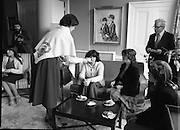 Galway Travellers Visit U.S.Embassy.    (N67)..1981..01.04.1981..04.01.1981..1st April 1981..Elizabeth,the wife of American Ambassador Mr William Shannon,invited a group of Galway travellers to afternoon tea at the residence in Phoenix Park, Dublin...Mrs Shannon,still wearing the Galway shawl, is photographed offering tea to her guests.