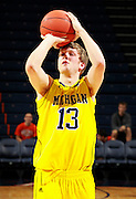 CHARLOTTESVILLE, VA- NOVEMBER 29: Matt Vogrich #13 of the Michigan Wolverines shoots the ball before the game against the Virginia Cavaliers on November 29, 2011 at the John Paul Jones Arena in Charlottesville, Virginia. Virginia defeated Michigan 70-58. (Photo by Andrew Shurtleff/Getty Images) *** Local Caption *** Matt Vogrich