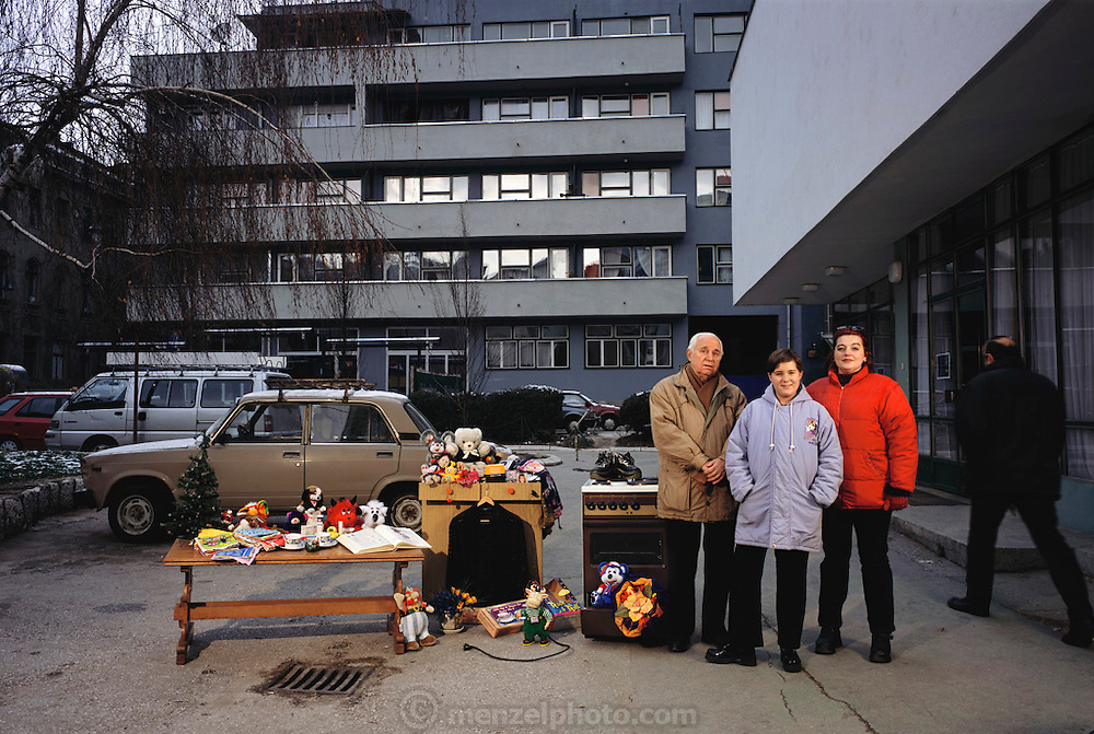 Portrait of the remaining Demirovic family members of Bosnia & Herzegovina, 2001, with whatever new possessions they have acquired since the shooting of their portrait with all of their possessions for Material World: A Global Family Portrait. Demirovic Family.