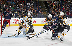 October 30, 2017 - Columbus, OH, USA - Columbus Blue Jackets center Tyler Motte (64) gets hit as he takes a shot by Boston Bruins defenseman Kevan Miller (86) and Boston Bruins center Riley Nash (20) during the third period of their NHL game at Nationwide Arena in Columbus, Ohio on Oct. 30, 2017. (Credit Image: © Kyle Robertson/TNS via ZUMA Wire)