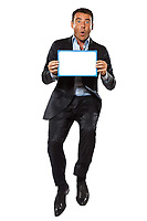 one caucasian surprised business man  jumping holding showing whiteboard in studio isolated on white background