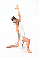 Exotic woman in pure white holding her hands in a sacred power yoga mudra.