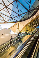Escalator from the plaza outside the Jeppesen Terminal to the train station at Denver International Airport, Denver, Colorado USA.