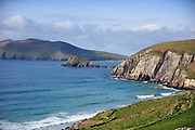 Surfers skim the waves off Coomeenole Beach in West Kerry on Sunday in pleasant Spring sunshine.<br /> Picture by Don MacMonagle - macmonagle.com