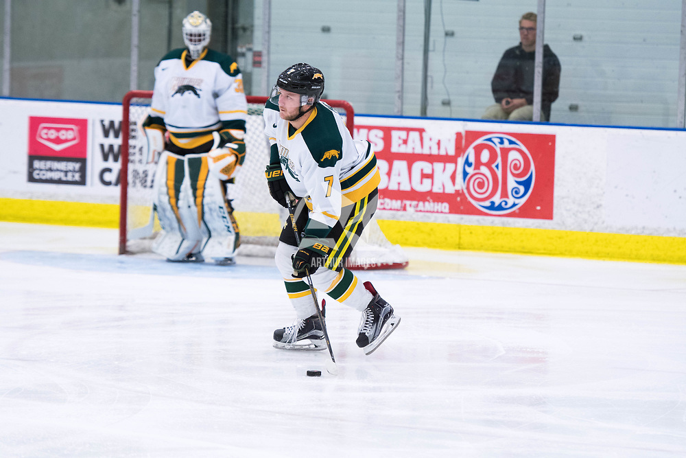 2nd year defence man Tyler King (7) of the Regina Cougars in action during the Men's Hockey Home Opener on October 6 at Co-operators arena. Credit: Arthur Ward/Arthur Images