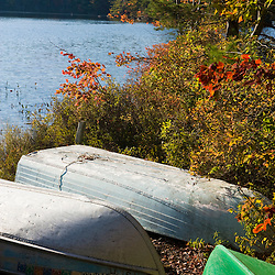 Boats on the shoreline of Long Pond in Lempster, New Hampshire.