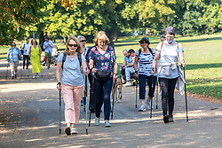 "© Licensed to London News Pictures. 15/09/2020. London, UK. Groups of walkers enjoy the warm sunshine this morning as Police patrol Hyde Park enforcing the ""Rule of Six"" as the mini-heatwave continues in the South East of England with highs of 29c. Prime Minister Boris Johnson announced last week that gatherings of more than six people will be banned from Monday (yesterday) in the hope of reducing the coronavirus R number. The Rule of Six has already become unpopular with MPs and large families for being too strict. Photo credit: Alex Lentati/LNP"