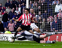 Photo. Glyn Thomas.<br /> Sunderland v West Ham United.<br /> Nationwide Division 1.<br /> Stadium of Light, Sunderland. 13/03/2004.<br /> West Ham's keeper Stephen Bywater initially makes a save from Sean Thornton's shot as Matthew Piper (L) looks on but Jeff Whitley pounces on the loose ball to give Sunderland a 2-0 lead.