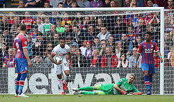 Bournemouth's Callum Wilson collects the ball from the back of the net after team mate Jordon Ibe scores to make it 3-2 during the Premier League match at Selhurst Park, London.