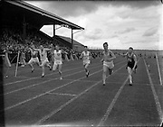 28/07/1956<br /> 07/28/1956<br /> 28 July 1956<br /> Athletics- All Ireland Athletic and Cycling Championships at the Iveagh Grounds, Dublin. Image shows end of a race.
