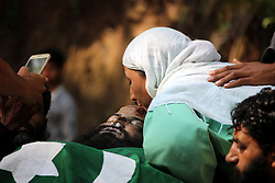 May 28, 2017 - Pulwama, Jammu and Kashmir, India - Unknown Relative kisses the body of Hizbul Mujahideen rebel Subzar ah Bhat at village Ratsuna ,Tral  in Pulwama , south of Srinagar Subzar Ahmed, aged 30, and a teenage boy Faizan Ahmed were the deceased in the night long encounter. (Credit Image: © Muneeb Ul Islam/Pacific Press via ZUMA Wire)