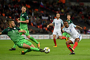A shot by England midfielder Raheem Sterling is blocked by Slovenia defender Bostjan Cesar during the FIFA World Cup Qualifier match between England and Slovenia at Wembley Stadium, London, England on 5 October 2017. Photo by Martin Cole.
