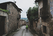 Julie, from the United States, walks down Calle Real in Campo, which was once the Jewish quarter of Ponferrada, Spain. (July 2, 2018)<br />