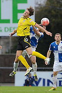 Chesham United midfielder Sam Youngs jumps for a header during the The FA Cup match between Bristol Rovers and Chesham FC at the Memorial Stadium, Bristol, England on 8 November 2015. Photo by Alan Franklin.