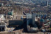 Nederland, Zuid-Holland, Den Haag, 20-03-2009; Hoogbouw van ministeries direct naast het station Den Haag Centraal. Als eerste VROM met daaraan vastgeplakt de Hoftoren (ministerie OCW). De rode bakstenen toren met groene bovenkant is de Zurichtoren (huisvest onder andere de OPTA en NMA), de dubbel toren met blauwe daken is Castalia, bijgenaamd de Haagse Tieten - ministerie VWS. De kranen staan aan de bouwput van de JuBi (Justitie en Binnenlandse zaken). De hoogbouw rechterbovehoek, 'het Strijkijzer', aan het Rijswijkseplein, omgeving station Hollands Spoor. Linksboven de Utrechtsebaan. View on the Central Station of The Hague (bottom left) on the right the high rise of a.o. Ministry of Education, Culture and Science and the Ministry of Health residing in the twin buildings called The Tits.  Swart collectie, luchtfoto (toeslag); Swart Collection, aerial photo (additional fee required); .foto Siebe Swart / photo Siebe Swart